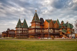 The palace of Tsar Alexei Mikhailovich is a wooden royal palace in Kolomenskoye in Moscow. Wooden fairy russian palace with green roofs