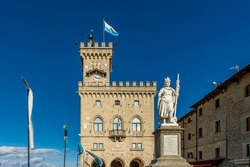The Palazzo Pubblico and the statue of liberty in the historic center of San Marino on a sunny day