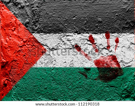 The Palestinian flag painted on grunge wall with bloody palmprint over it