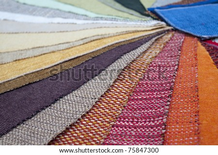 The palette of the furniture upholstery, shallow depth of field