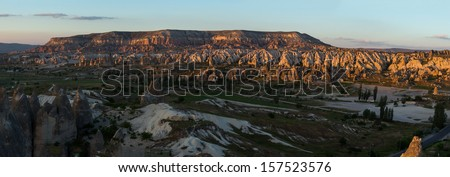 The panorama view of Cappadocia, Turkey. This is the sunset time.