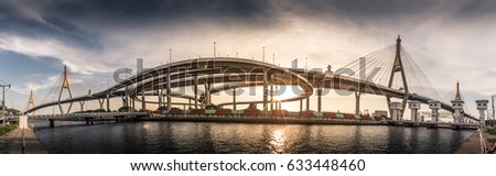 The panoramic photography of the long bridge and the sunlight is backdrop. The panoramic photography of Bhumibol bridge in Bangkok Thailand.