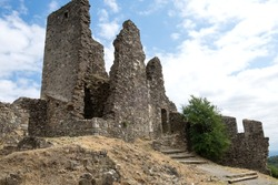 The panoramic scenery of old ruins of medieval castle and fort called Four castles of Lastours in Pyrenean mountains, France