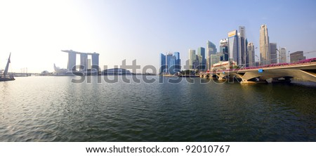 The panoramic skyline of Singapore financial district in morning sunlight as seen from Esplanade