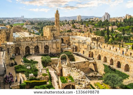 """The panoramic view of the ancient citadel """"Tower of David"""" in Jerusalem, Israel. Ancient city walls"""