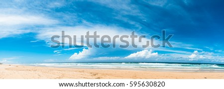 The panoramic view of the ocean beach with beautiful bright cloudy sky in Gold Coast, Australia #595630820