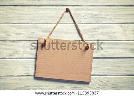the paper board hanging on wooden wall