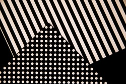 The paper is black and white. Different geometric shapes. White circles and stripes. Abstract background and texture. Space for the text.