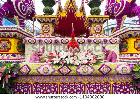The parade cars are decorated with many kinds of flowers in annual 42th Chiang Mai Flower Festival, Thailand