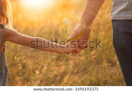 the parent holds the hand of a small child Stock photo ©