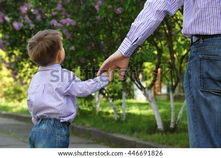 the parent holds the hand of a small child #446691826