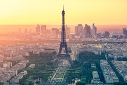 The Paris city skyline at sunset with the Eiffel Tower in Paris, France.