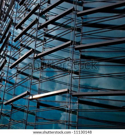 The part of abstract building with mirrored blue sky