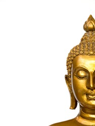 The part of face golden antique buddha statue on the white background (isolated background). The face of the Buddha is Straight face. copyspace for text and content