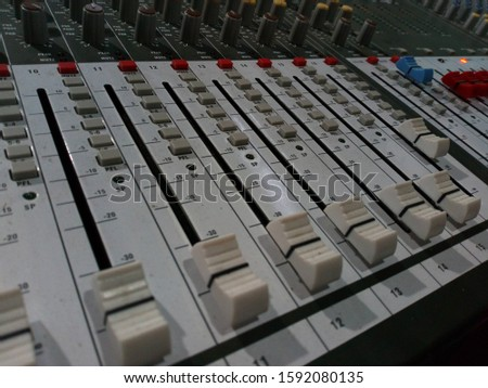 The part of Musical amplifier Sound amplifier or Music mixer with Knobs and Jack holes Picture of Musical amplifier Sound amplifier or Music mixer with Knobs. perfect for music background concept.