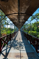 The passageway of a pedestrian bridge that is empty during the day