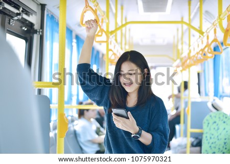 The passenger use smartphone in the bus or train, technology lifestyle, transportation and traveling concept