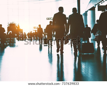 The passengers in the airport, the business background.