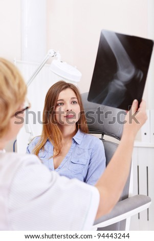 The patient with the doctor looking at x-ray