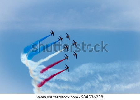 The Patrouille de France aerobatic demonstration team of the French Air Force making flag figure of colred smoke traces in the sky during Le Bourget Paris air show
