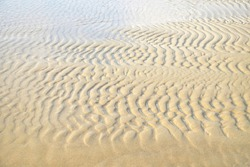 The patter of sand waves at the thai beach, the creative of nature.