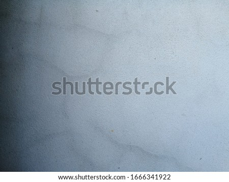 The​ pattern​ of​ surface​ wall​ concrete​ damaged​ by​ rust​y​ for​ background. Rust​ damaged​ to​ surface​ wall​ concrete​ for​ background​ stock photo