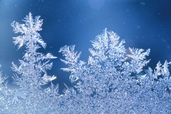 The patterns made by the frost on the window (hoarfrost background)