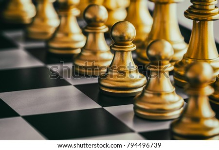 The Pawn in battle chess game stand on chessboard with black isolated background. Business leader concept for market target strategy. Intelligence challenge and business competition success play.  ストックフォト ©