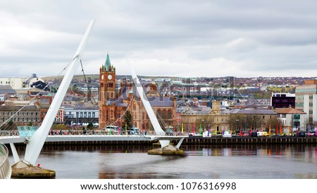 The Peace Bridge over the river Foyle and Guildhall, Derry/Londonderry, Northern Ireland. Birthplace of John Hume