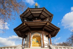 The Peace Pagoda in Battersea Park London England with gilded bronze gold Buddha statues which is a popular travel destination tourist attraction landmark of the city