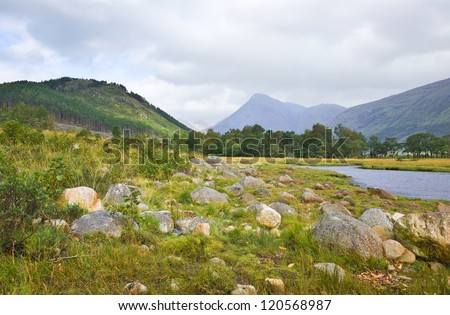The peaceful shores of Loch Etive, hidden among the mountains in Glen Etive, a remote valley near Glencoe in the Scottish Highlands.