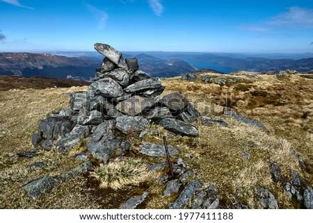 The peak of Mount Skåldalsfjellet. Hiking the mountains Skåldalsnipa (603 meter), Skåldalsfjellet (718 meter), Herlandsfjellet (696 meter) and Garnesrinden (625 meter) in Bergen, Norway
