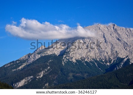 The Peak of the Watzmann with a low cloud