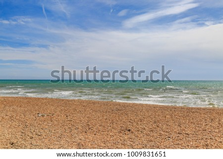 The pebble beach at Brighton on a sunny summers day #1009831651