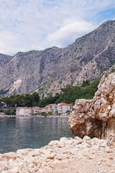 The pebbled beach in the village of Drasnice which is a tourist locality in southern Dalmatia, Croatia, located between Makarska and Podgora close to the Biokovo mountains