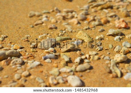 the pebbles of warm tan and taupe colors at oahu beach #1485432968
