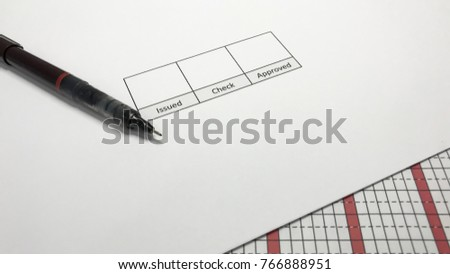 """The pen is on paper. There is space for signature. """"Issued, Check, Approved"""" Presentation of work ideas, signing documents, issuing documents, checking documents, approving documents. #766888951"""