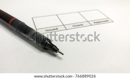 """The pen is on paper. There is space for signature. """"Issued, Check, Approved"""" Presentation of work ideas, signing documents, issuing documents, checking documents, approving documents. #766889026"""