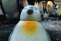 The penguin statue feels happy.