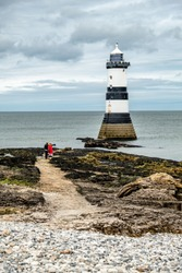 The Penmon point lighthouse is located close to Puffin Island on Anglesey, Wales - United Kingdom.