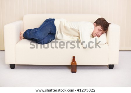 The people comfortable sleeps on the sofa having got drunk beer