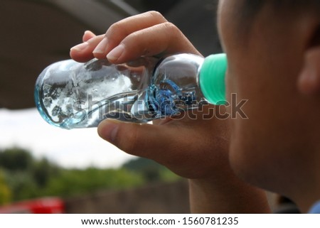 The People drinking ramune drink