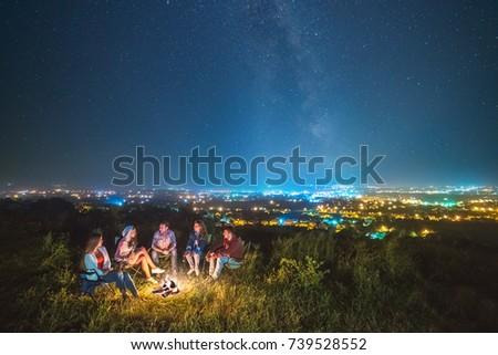 the people rest near a bonfire...