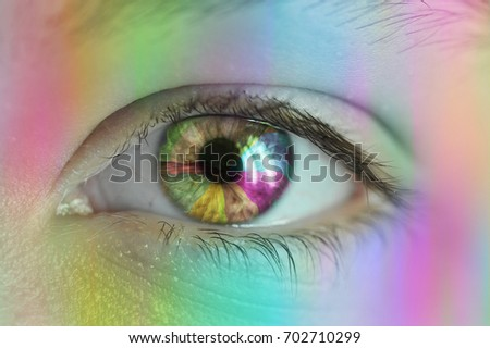 The Perception of color - human eye up close reflecting light and rainbow colors