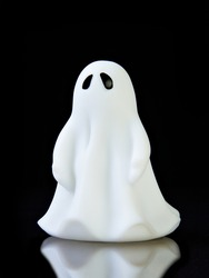 The perfect ghost on black background with reflection and copy space