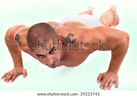The perfect muscular male doing push-ups
