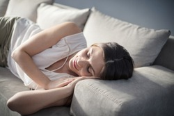 The perfect place for a power nap Woman napping on sofa.
