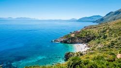 "The perfect secret beach: white pebbles beach and turquoise sea, surrounded by luxuriant vegetation of the natural reserve ""Riserva dello Zingaro"", San Vito Lo Capo, Sicily, Mediterranean Sea, Italy."
