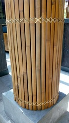 the perspective view from natural bamboo slat in parallel and round position part of the restaurant building construction as architectural design element