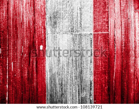 The Peru flag painted on wooden pad